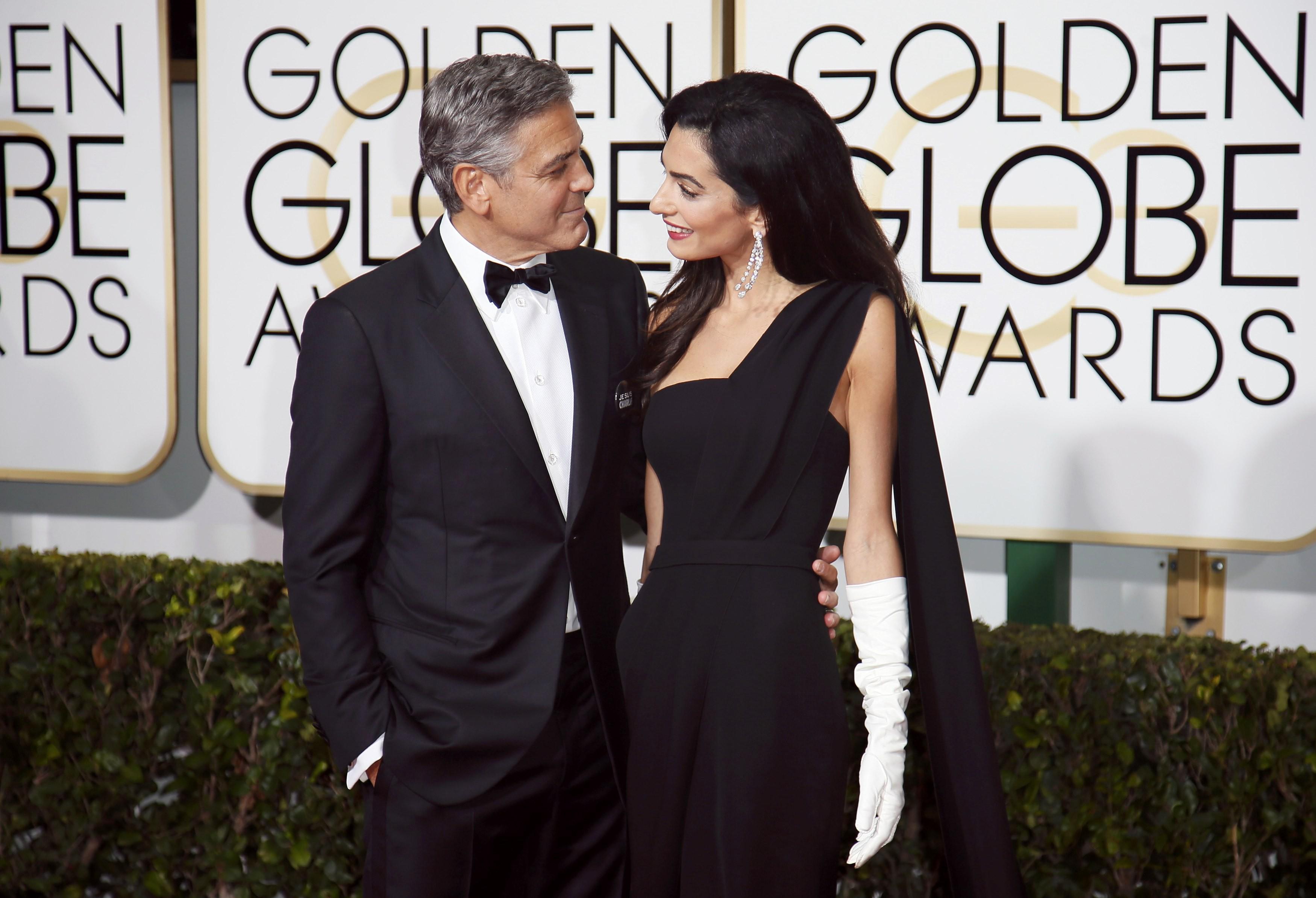 جورج كلوني وزوجته يستقبلان طفليهما في لندن