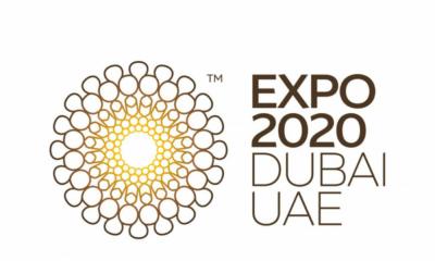 معالم دولة الإمارات ولوحة إعلانات ناسداك في تايمز سكوير - نيويورك تضاء باللون الأصفر مع بدء إكسبو 2020 دبي